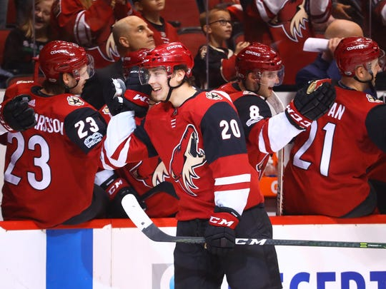 Dylan Strome celebrates with teammates after scoring