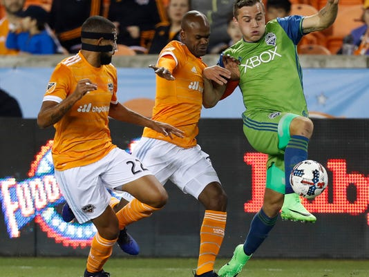Seattle Sounders forward Jordan Morris (13) battles for control of the ball against Houston Dynamo defender Adolfo Machado (3) during the first half of the season-opening MLS soccer game Saturday, March 4, 2017, in Houston. (Karen Warren/Houston Chronicle )