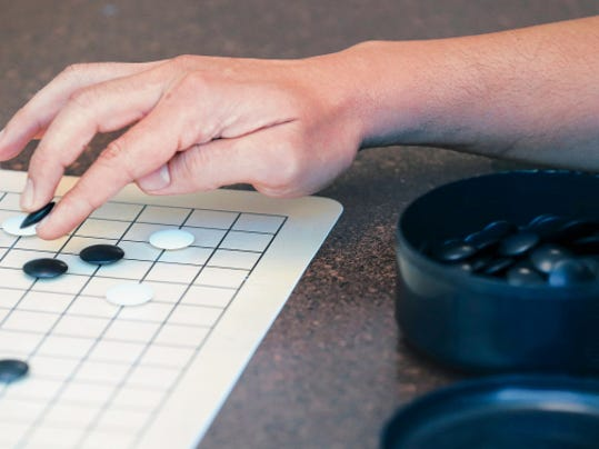 RUBEN R RAMIREZ—EL PASO TIMES  The board and game pieces used by players for the ancient Japanese game of Go is often compared to chess.