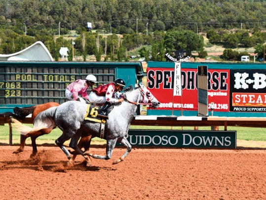 Tommy Galvez and Tony Sedillo's Flyin Fish made a stretch run, gained the lead and then held off determined frontrunner An Absolut Diamond to take the 30,000 Fine Loom Handicap over 870 yards on Saturday afternoon at Ruidoso Downs.