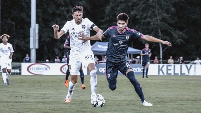 Tormenta's Nil Vinyals fights for possession Saturday against Orlando.