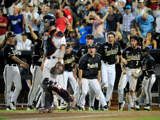 Vanderbilt players react to a John Norwood's home run against Virginia in the eighth inning Wednesday.