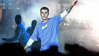 This file photo taken on Sept. 20, 2016, shows Canadian singer Justin Bieber performing on stage at the AccorHotels Arena in Paris. He has canceled the remaining shows of his highly successful Purpose World Tour.