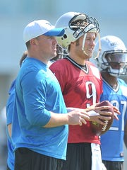 Jim Bob Cooter is pictured with Matthew Stafford in training camp.
