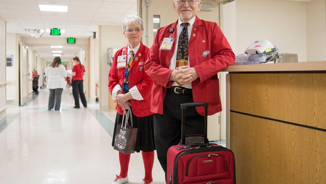 Marie and Jeff Clements, volunteers at IU Health Ball Memorial Hospital, help deliver gifts to those still in the hospital as the holiday approaches. The two have nearly 3,000 volunteer hours a piece.
