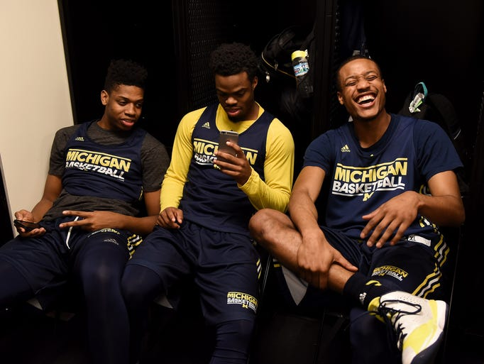 Michigan guard Muhammad-Ali Abdur-Rahkman (12), right,
