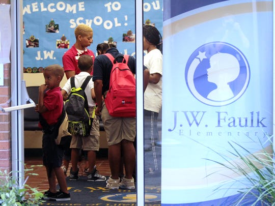 Students and teachers head back to school Tuesday, August 12, 2014, at J.W. Faulk Elementary.