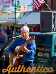 Photo of this guitar player in El Centro shopping district is one of many being used in the Downtown Authentico marketing campaign.