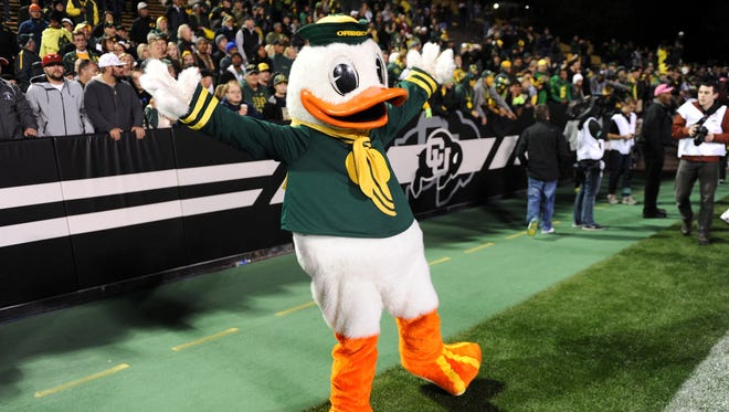 Oct 5, 2013; Boulder, CO, USA; Oregon Ducks mascot The Duck reacts following the win over the Colorado Buffaloes at Folsom Field. The Ducks defeated the Buffaloes 57-16.