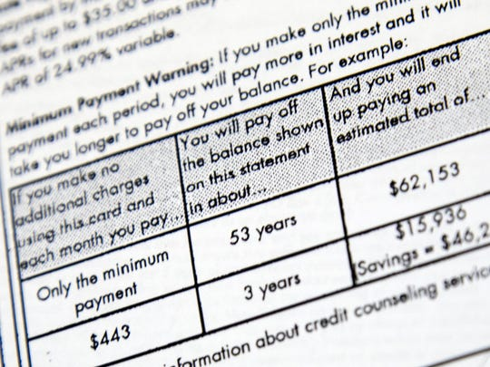 A client's credit card statement of a debt just under $12,000 shows that if payed at the minimum amount, it will take 53 years to pay off at a cost of 62 thousand dollars, at Green Path Debt Solutions in Monroe, Wednesday, October 15, 2014.