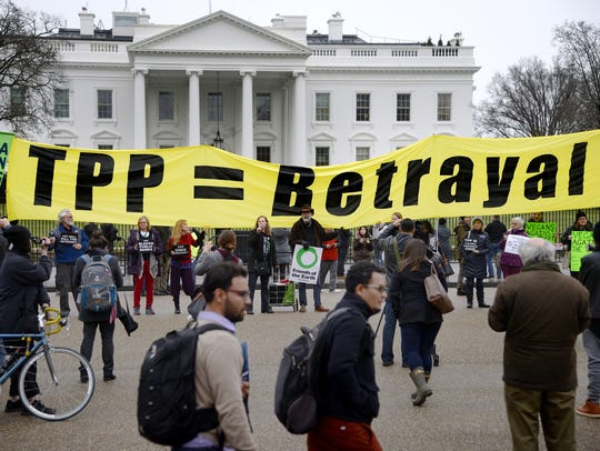 Activists hold a rally to protest the Trans-Pacific