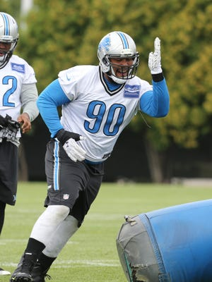 Detroit Lions defensive tackle Gabe Wright goes through drills on Aug. 26, 2015, at the practice facility in Allen Park.