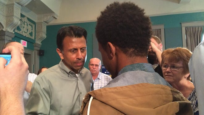 Gov. Bobby Jindal speaks with a constituent during his town hall meeting at the Cedar Rapids Art Museum on Saturday.