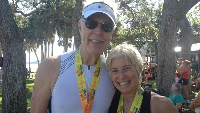 Herb and Susan Blauel after a recent triathlon. The duo will be competing in this weekend's Battle of the Bridges Triathlon.