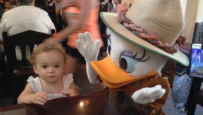 Isabella enjoys a visit from Daisy Duck at Tusker House at Animal Kingdom.