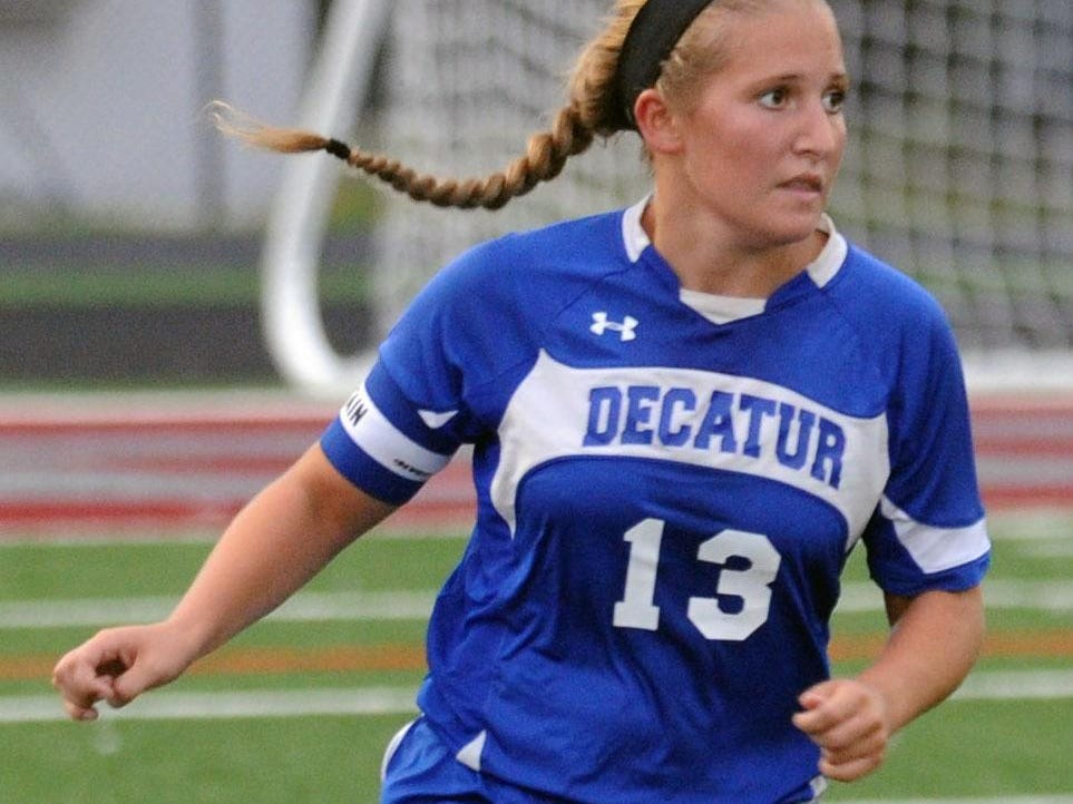 Stephen Decatur senior captain Alexis McDonough works the ball up the field against Snow Hill on Monday.