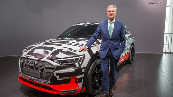 Audi CEO Rupert Stadler, shown here with a prototype of an upcoming electric Audi SUV, was arrested in June in connection with VW's emissions-cheating scandal.