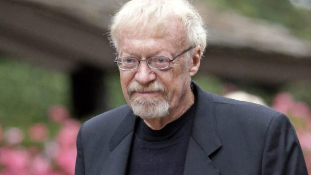 "FILE - In this July 11, 2013 file photo, Phil Knight, the co-founder and chairman of Nike, Inc., walks to the morning session at the Allen & Company Sun Valley Conference in Sun Valley, Idaho. Scribner announced that ""Shoe Dog"" will be the title Thursday for Knightís book and set an April 26 release. The memoir, first announced last year, will cover the early years of Nike, when Knight in 1964 started what became the iconic company through a handshake deal with his track coach at the University of Oregon, Bill Bowerman. (AP Photo/Rick Bowmer, File) ORG XMIT: NYET431"