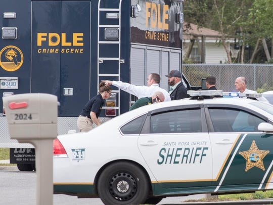 FDLE investigates the scene of an officer involved shooting on Bright Water Drive in Midway on Tuesday, March 27, 2018.