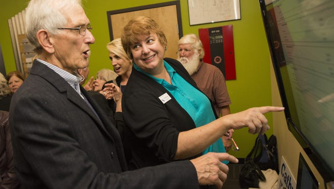 Cathy Kipp, Poudre School District Board of Education incumbent, looks at election results with Wayne Gutowsky during a watch party at Fort Collins Brewery  in November 2015.