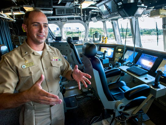 Commander Mark Stefanik on the bridge of the USS Montgomery