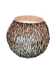Take a seat on a plump, round ottoman.
