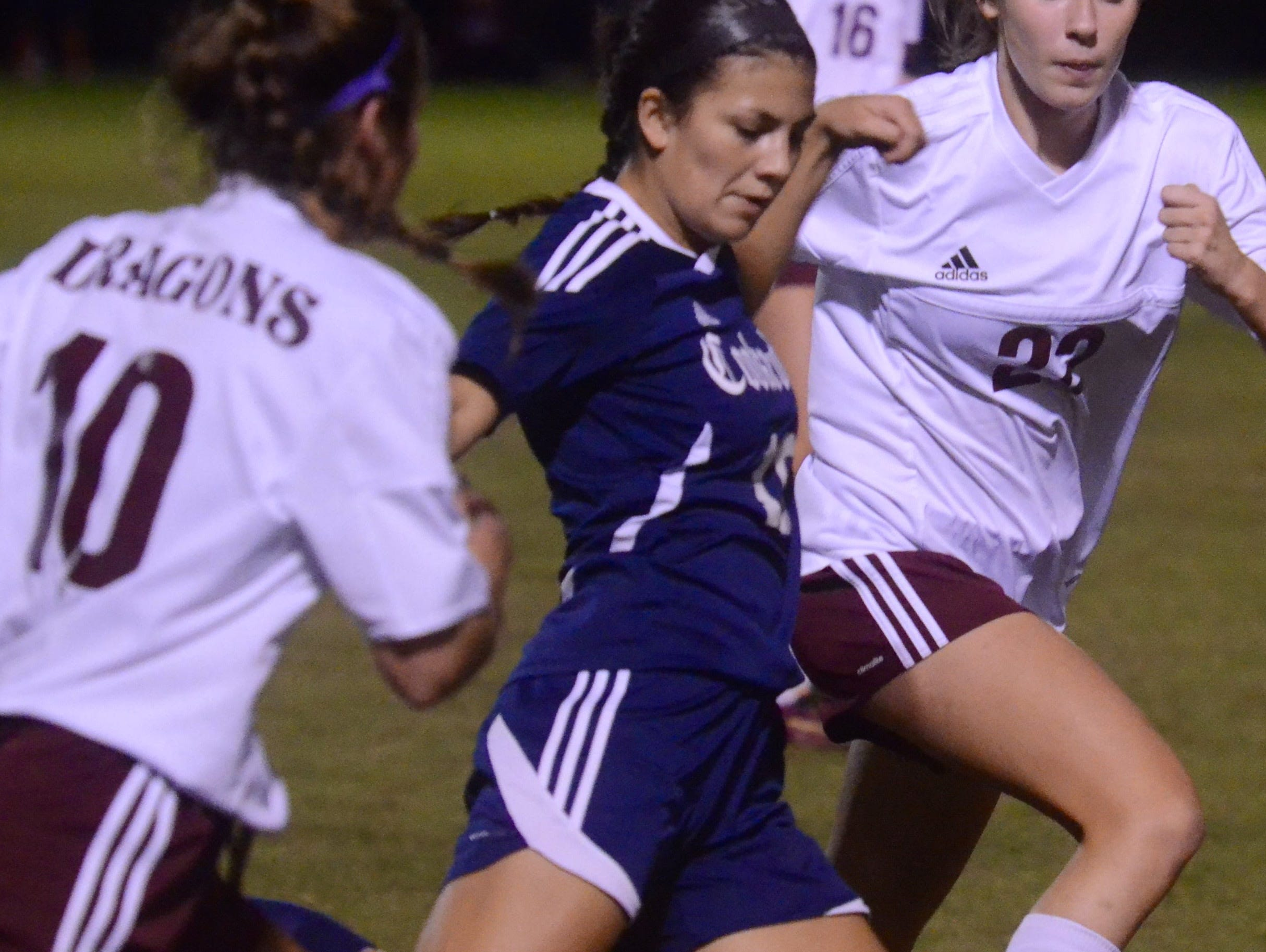 Cookeville senior midfielder Andrea Ramirez (middle) clears the ball upfield during Thursday's Class AAA quarterfinal match against Collierville.
