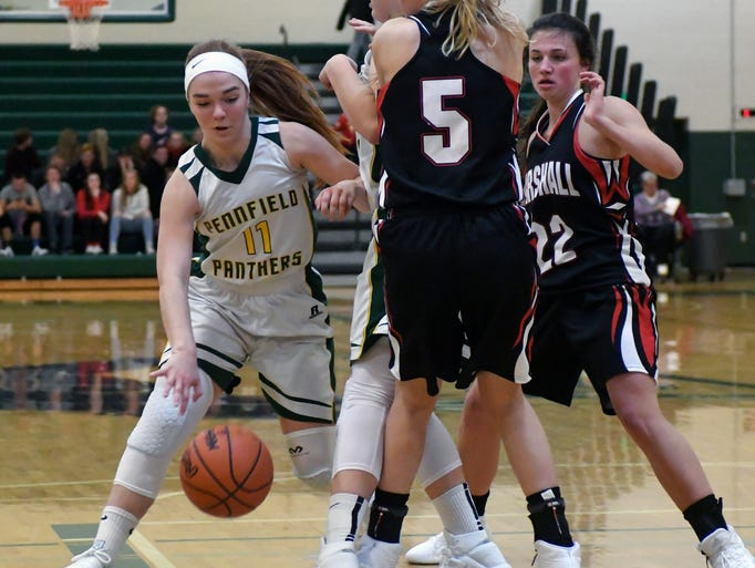 Pennfield's Melanie McIntyre (11) works to get past