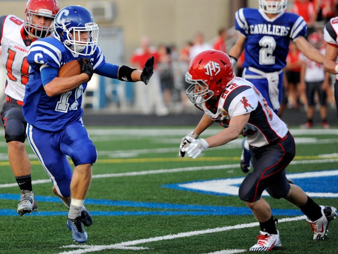 Chillicothe High School football player Nathan Rosenbauer prepares to block a Johnstown player Hayden Bullard while running the ball during the game at Herrnstein Field on Friday.