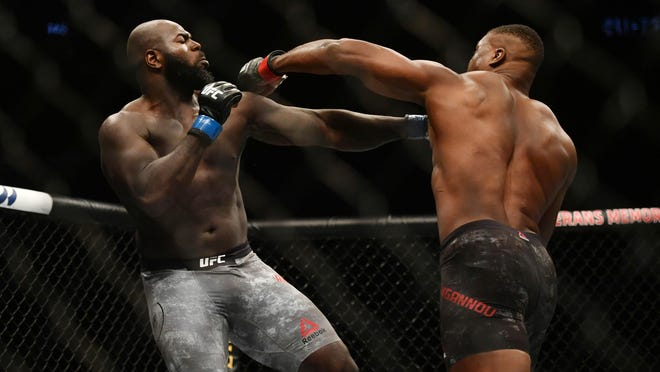 Francis Ngannou (red gloves) knocks out Jairzinho Rozenstruik after only 20 seconds in a heavyweight fight at UFC 249 in Jacksonville.