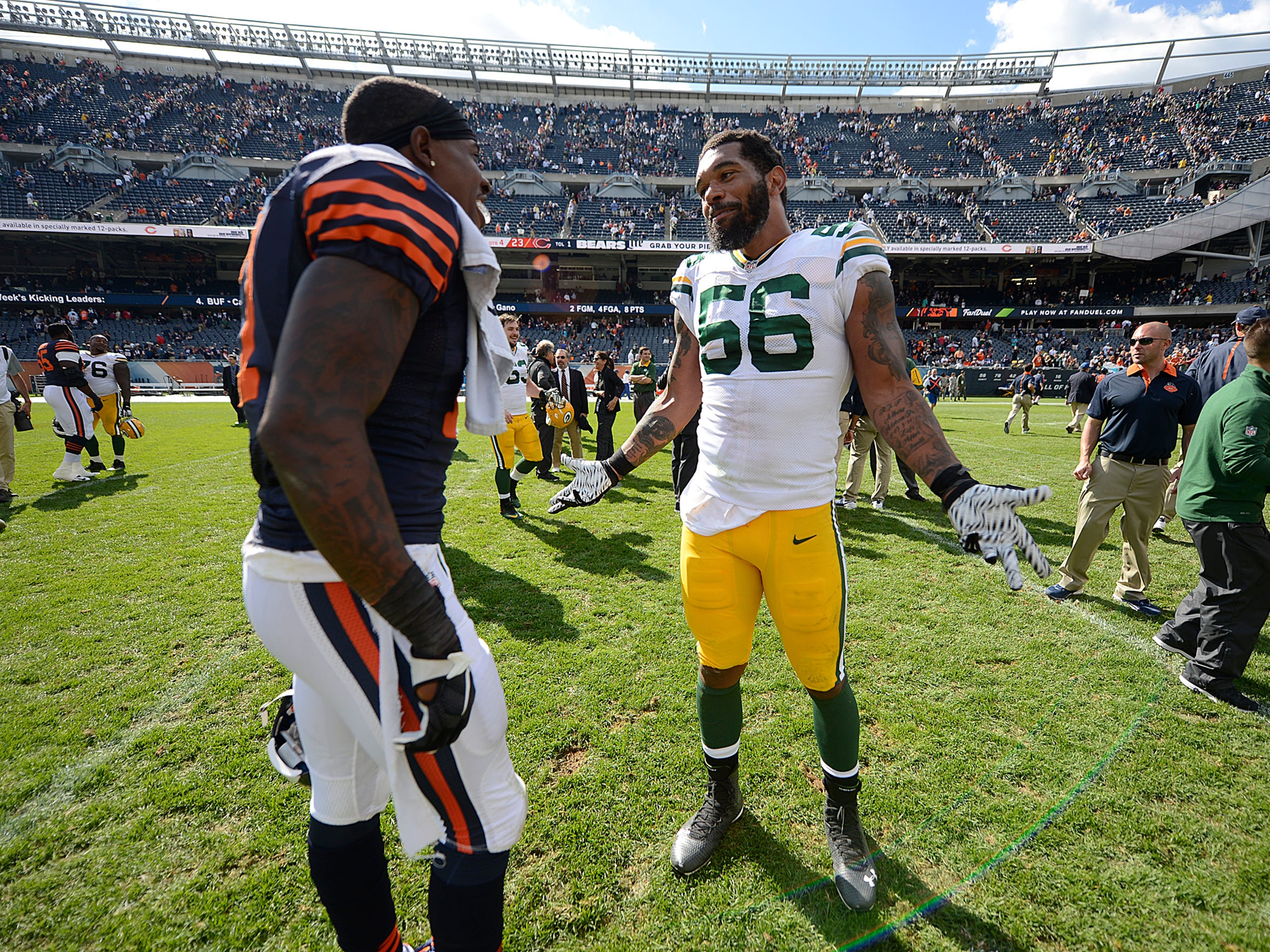 Green Bay Packers linebacker Julius Peppers has some fun with Chicago Bears receiver Alshon Jeffery after Sunday's game at Soldier Field in Chicago. The Packers defeated the Bears 31-23.