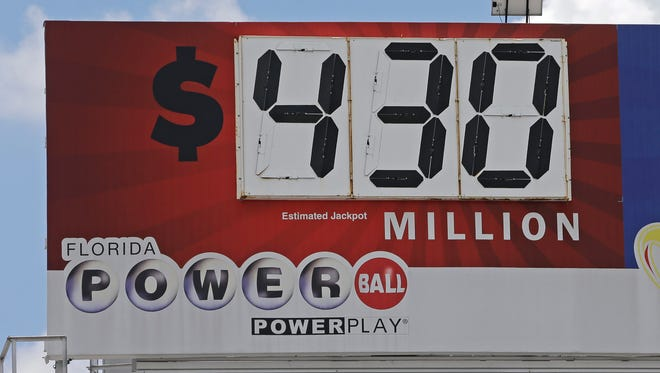 A billboard shows the Powerball prize, Tuesday, Aug. 15, 2017, in Miami. The Powerball jackpot has rolled 18 times, since the June 14, drawing, resulting in an estimated $430 million for Wednesday night's drawing.