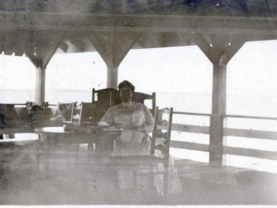 Mina Edison enjoys time in a pavilion at the end of a pier on the Edison estate in Fort Myers.