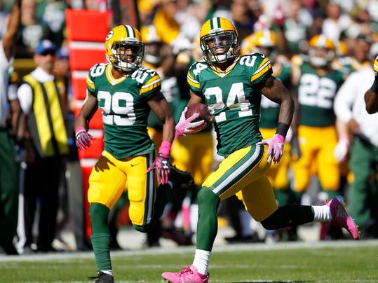 FILE - In this Sunday, Oct. 11, 2015 file photo, Green Bay Packers' Quinten Rollins (24) runs back an interception for a touchdown during the first half an NFL football game against the St. Louis Rams in Green Bay, Wis. The Green Bay Packers are so confident in their new-and-improved cornerback group that they released the player who shadowed Atlanta Falcons star receiver Julio Jones in last season's NFC championship game, a blowout win for Atlanta. Cornerbacks Davon House, Damarious Randall and Quinten Rollins hope for better results on Sunday, Sept. 17, 2017 when the Packers visit the Falcons again. (AP Photo/Matt Ludtke, File)