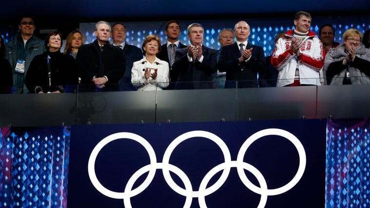 Feb 23, 2014; Sochi, RUSSIA; Russia president Vladimir Putin (third from left), bobsled gold medalist Alexander Zubkov (second from right), IOC president Thomas Bach (fourth from right), and IOC former president Jacques Rogge (front row, second from left)  in attendance during the closing ceremony for the Sochi 2014 Olympic Winter Games at Fisht Olympic Stadium. Mandatory Credit: Jeff Swinger-USA TODAY Sports