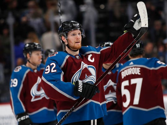 Colorado Avalanche left wing Gabriel Landeskog acknowledges the fans as time runs in the third period of an NHL hockey game against the Arizona Coyotes Saturday, March 10, 2018, in Denver. The Avalanche won 5-2. (AP Photo/David Zalubowski)