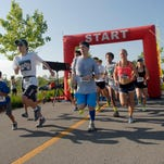 Nine hundred and fifty people participate in the FEAT (Families for Effective Autism Treatment) of Louisville's 10h Annual Outrunning Autism 5K Run and Fun Walk at Beckley Creek Park.  May 30, 2015