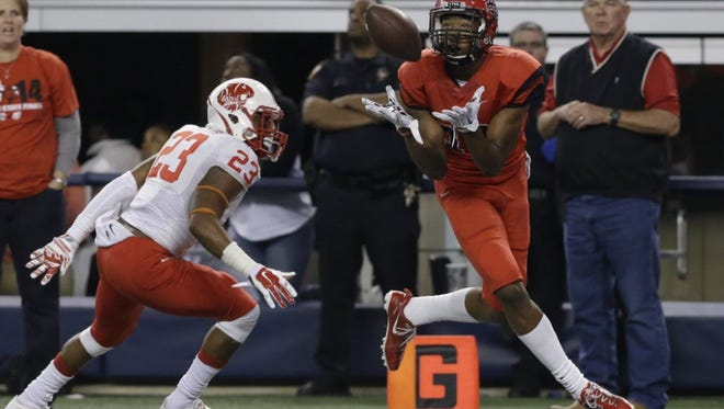 Ole Miss commit DaMarkus Lodge catches a pass in the Texas state championship game