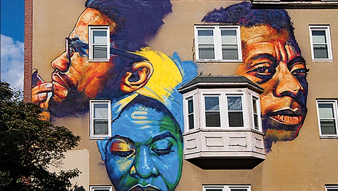 A mural in Baltimore depicts James Baldwin (right) along with Malcolm X (left) and Nina Simone.
