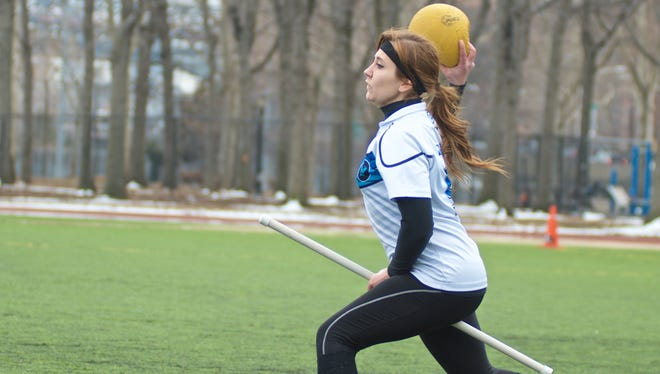 """""""There are teams across the country and around the world,"""" says Amanda Dallas, assistant coach of NYC-based Quidditch team The Warriors. Dallas is wielding a bludger during a competition."""