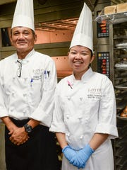 Pastry chef Myra Tiamzon, right, poses for a photo with Executive Sous Chef Edwin Munez in the kitchen of the Lotte Hotel Guam in Tumon on Monday, Dec. 21.