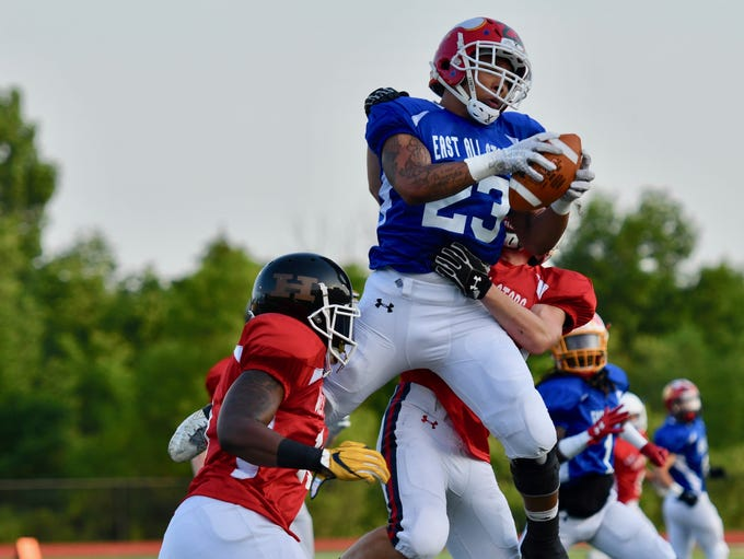 Tyrese Sherman (Princeton) leaps and makes a catch