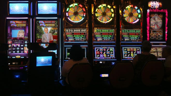 Gamblers place their bets at video slot machines at Belterra Park in Anderson Township last week. The racino's executives haven't been pleased with its performance.