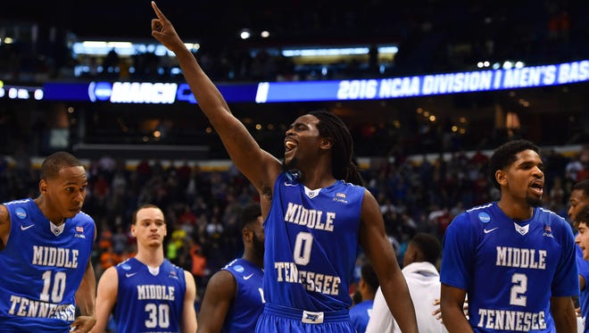 Middle Tennessee Blue Raiders players celebrate after the game against the Michigan State Spartans in the first round in the 2016 NCAA Tournament at Scottrade Center. Middle Tennessee State won 90-81.