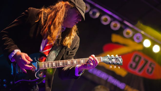 Thunderstruck, an AC/DC cover band, played the Strawberry Alley stage for hundreds in the audience on Friday.