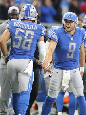 Matthew Stafford congratulates Paul Worrilow in the fourth quarter of the Lions' 35-23 win over the Cardinals, Sunday, Sept. 10, 2017 at Ford Field.