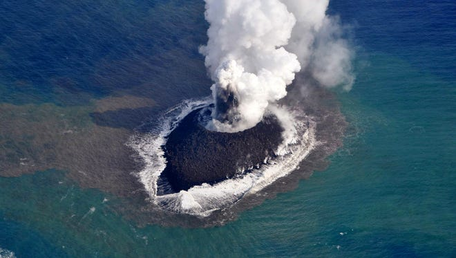 Smoke rises from a new island volcano near the Ogasawara island chain on Nov. 21 600 miles south of Tokyo.