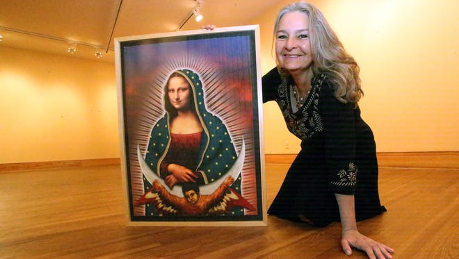 """Artist Diana Molina, executive director of Juntos Art Association, shows a digital print by San Antonio artist César Martínez titled """"La Mona Lupe"""" at the Centennial Museum on the UTEP campus. It is among works by 26 artists in the group's upcoming exhibit there titled """"Icons and Symbols of the Borderland."""""""