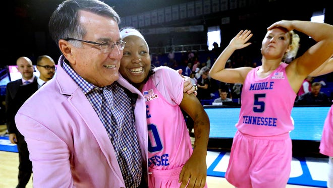 MTSU's Head Coach Rick Insell gives a hug to senior Ty Petty (20) after the 94-69 win over Marshall on Saturday, Feb. 18, 2017. MTSU's Abbey Sissom (5) stands in the background.