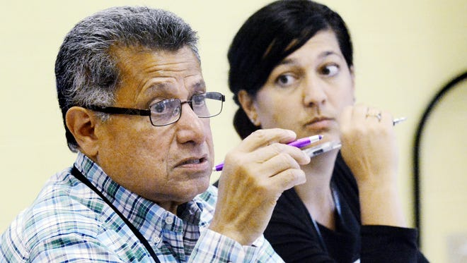 Helen Thackson Charter School CEO Carlos Lopez and principal Melissa Achuff address the school board during a rescheduled board meeting Wednesday, Aug. 9, 2017. Bill Kalina photo